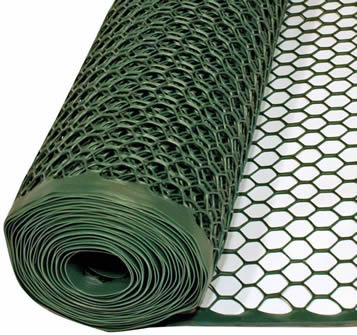 A roll of green hexagonal poultry fence on the white background.